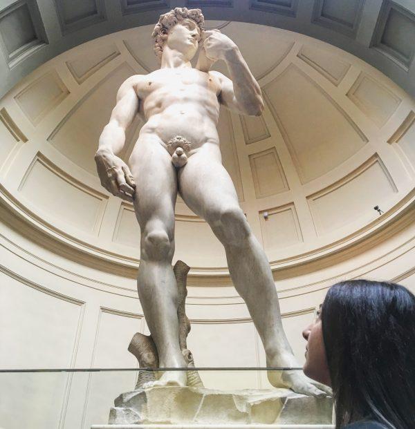 Girl looking at Michelangelo's David