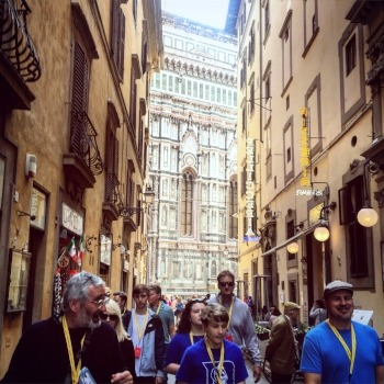 a tour guide with a group near the duomo