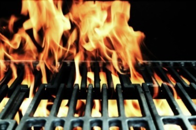 Hot Grill Pan with flames for cooking at Steak